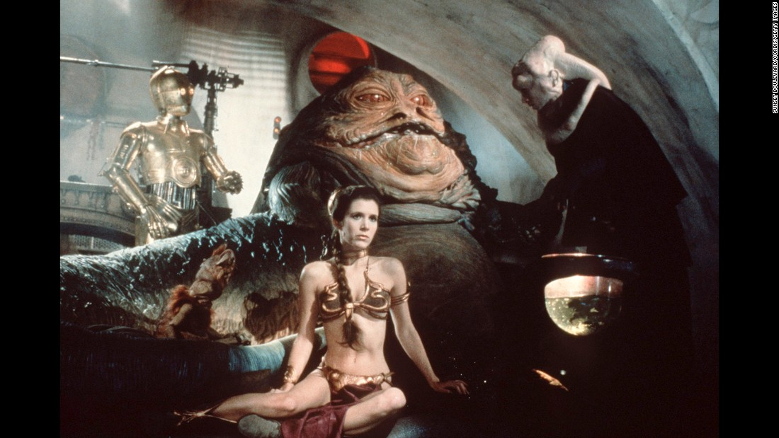 "Fisher stars in the film, ""Star Wars: Episode VI -- Return of the Jedi"" in 1983. The 'gold bikini' is one of her most famous costumes as Princess Leia. In addition to her acting career, Fisher -- who was <a href=""http://www.healthyplace.com/bipolar-disorder/articles/carrie-fisher-and-manic-depression/postcards-a-book-by-carrie-fisher/?t=s&url=/public_bookmarks.php"" target=""_blank"">diagnosed with bipolar disorder at age 24</a> -- has lobbied as an advocate for mental health awareness and treatment and has spoken before the California state Senate."