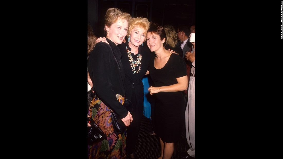 "Meryl Streep, left -- who portrayed a character based on Fisher in the film adaptation of Fisher's 1987 novel, ""Postcards from the Edge"" -- is seen at the film's premiere in Century City, California, on September 10, 1990."
