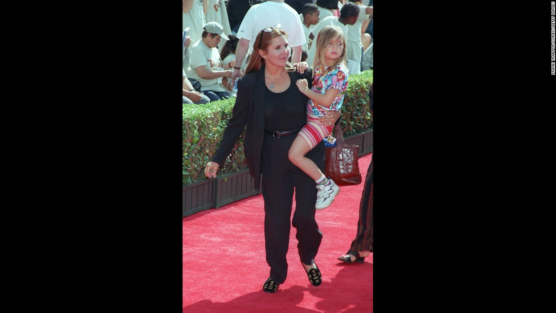 Fisher carries Billie Catherine Lourd -- her daughter with talent agent Bryan Lourd.