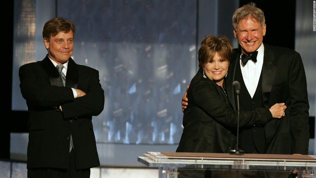 """Star Wars"" trio Mark Hamill, left, Fisher and Harrison Ford speak during a tribute to filmmaker George Lucas at the 33rd American Film Institute Life Achievement Award event in Hollywood on June 9, 2005."