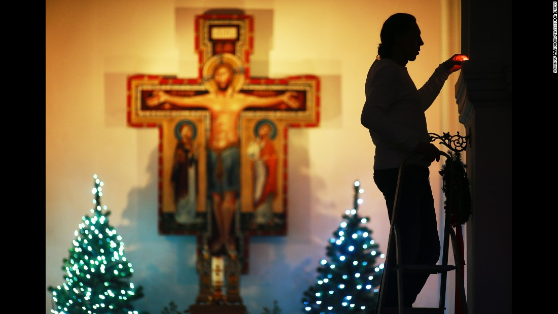 A worshiper lights a candle ahead of a traditional Christmas Eve Mass on December 24, in Vladimir, Russia.