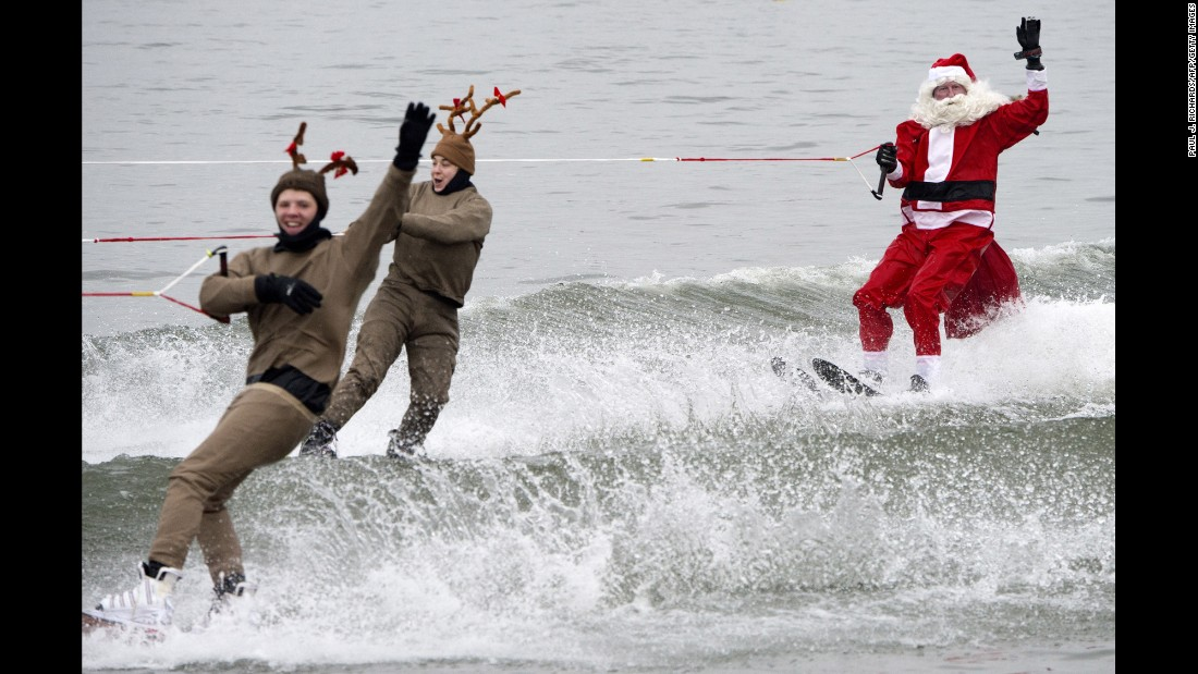 Members of the volunteer Water Skiing Christmas Show, dressed as Santa Claus and reindeer, water-ski on the Potomac River, in Alexandria, Virginia,on December 24.