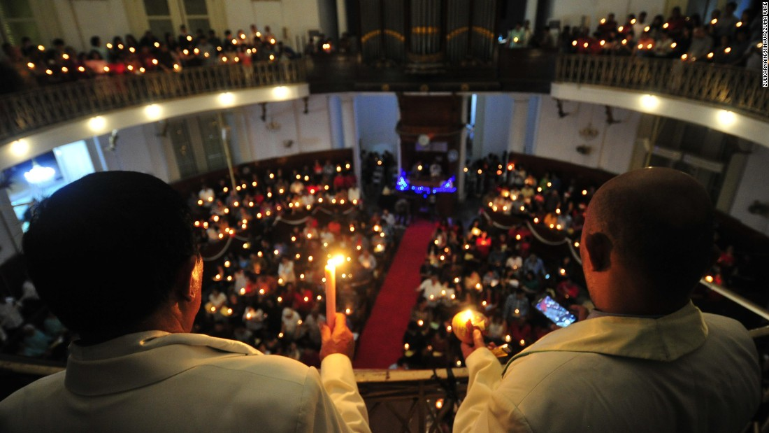 Christians in Indonesia hold candles at church services in Jakarta on December 24.