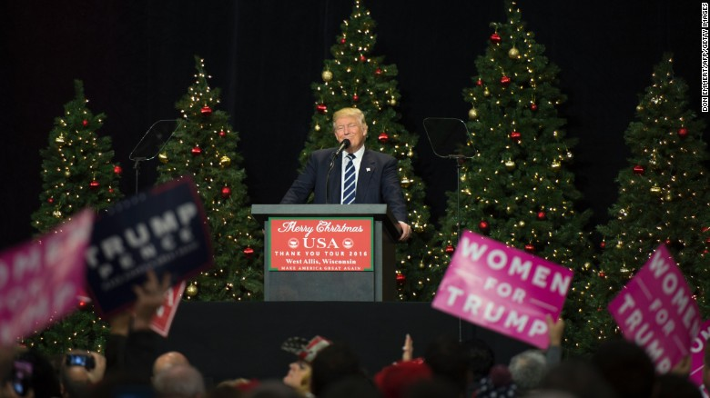 trump fist raised wishes all a merry christmas cnnpolitics com
