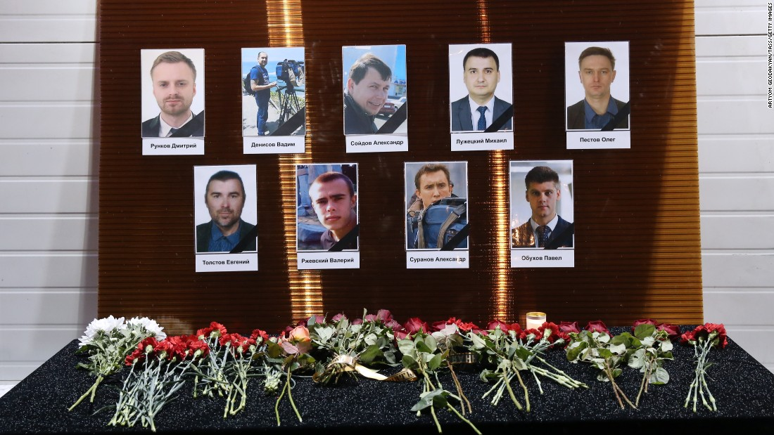 Photographs of Channel One, NTV and Zvezda TV journalists killed in the plane crash are seen outside the Ostankino Technical Center in Moscow.