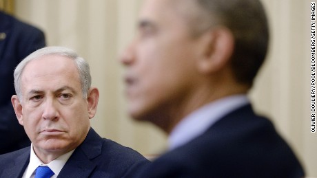 Benjamin Netanyahu, Israel's prime minister, left, looks on as U.S. President Barack Obama, speaks during a meeting in the Oval Office of the White House in Washington, D.C., U.S., on Monday, Nov. 9, 2015. Benjamin Netanyahu is looking past his fraught relationship with President Barack Obama to a more lasting concern as he visits Washington next week: rebuilding IsraelÕs standing with American Democrats. Photographer: Olivier Douliery/Pool via Bloomberg