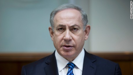 """FILE - In this Dec. 11, 2016, file photo, Israeli Prime Minister Benjamin Netanyahu attends the weekly cabinet meeting at his office in Jerusalem. Netanyahu lashed out at President Barack Obama on Saturday, Dec. 24, accusing him of a """"shameful ambush"""" at the United Nations over West Bank settlements and saying he is looking forward to working with his """"friend"""" President-elect Donald Trump. Netanyahu's comments came a day after the United States broke with past practice and allowed the U.N. Security Council to condemn Israeli settlements in the West Bank and east Jerusalem as a """"flagrant violation"""" of international law. (Abir Sultan, Pool via AP)"""