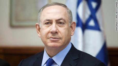 """Israeli Prime Minister Benjamin Netanyahu chairs the weekly cabinet meeting in Jerusalem on December 25, 2016. Israel was defiant over a UN vote demanding it halt settlements in Palestinian territory, after lashing out at US President Barack Obama over the """"shameful"""" resolution. / AFP / AP AND POOL / Dan Balilty        (Photo credit should read DAN BALILTY/AFP/Getty Images)"""