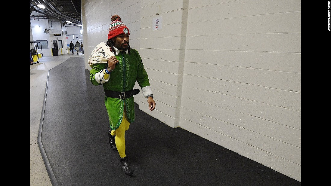 DeAngelo Williams of the Pittsburgh Steelers arrives at Heinz Field in Pittsburgh dressed as an elf before the game between the Steelers and the Baltimore Ravens on December 25.