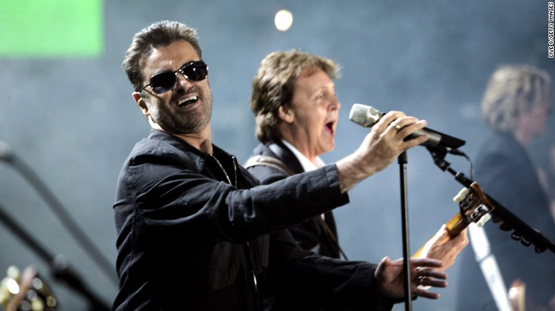 """George Michael, left, and Paul McCartney perform together at the """"Live 8 London"""" concert on July 2, 2005 in London."""