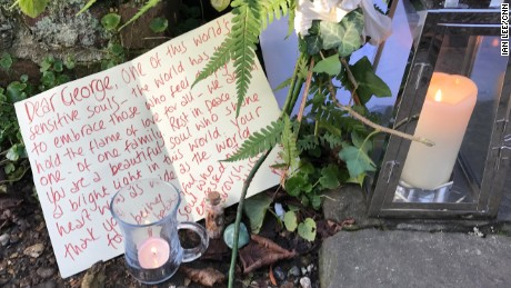 Flowers and letters have ben left by those visiting Michael's home.