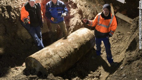 The bomb disposal team stand next to the World War II bomb they made safe in Augsburg, southern Germany, during a mass evacuation on December 25, 2016.