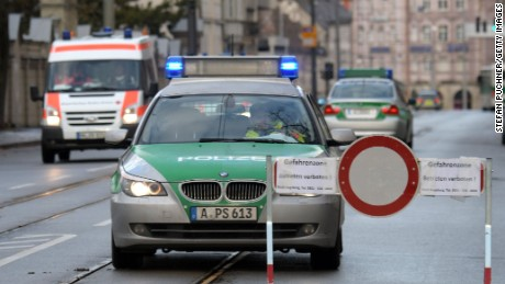 Police cars and an ambulance are seen beside a road block on an empty street in Augsburg, southern Germany, during a mass evacuation on Christmas Day.