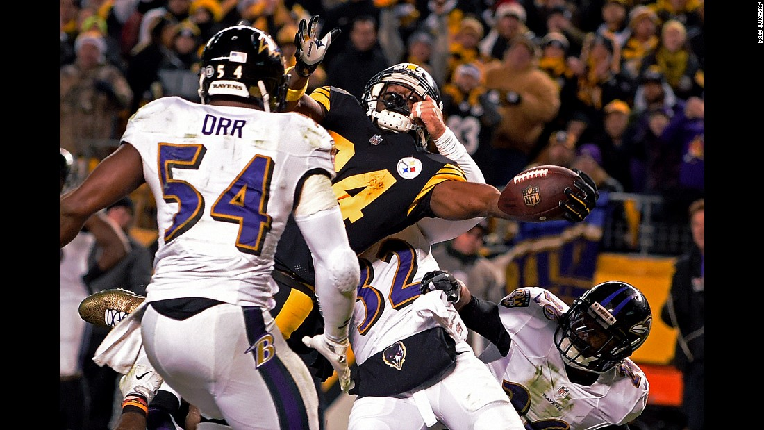 Pittsburgh wide receiver Antonio Brown reaches the ball across the goal line to score the winning touchdown in the final seconds of an NFL game against Baltimore in Pittsburgh, Pennsylvania, on Christmas day. Pittsburgh, which won 31-27, earned the AFC North title and will now go to the playoffs.