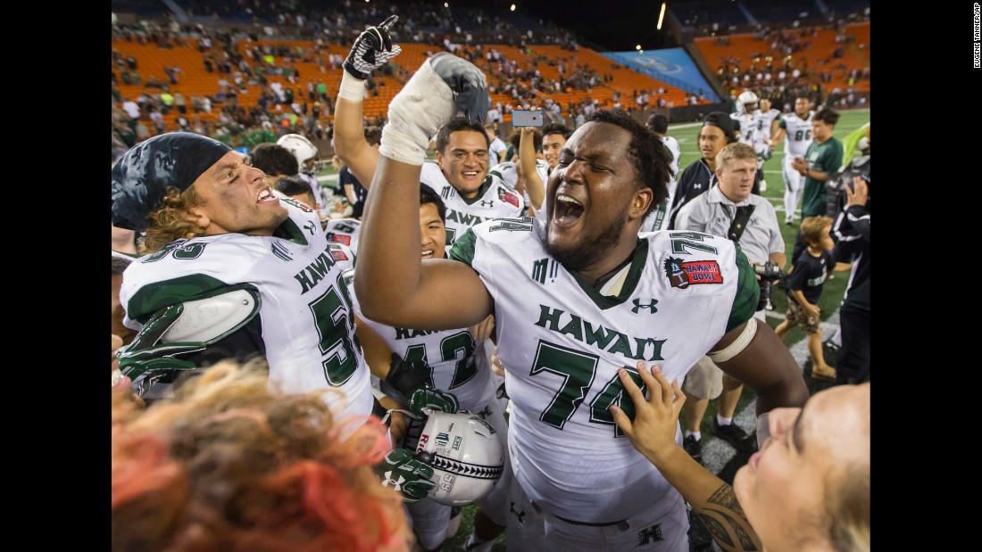 Hawaii offensive lineman RJ Hollis celebrates with teammates after they defeated Middle Tennessee 52-35 in an NCAA football game in Honolulu on Saturday.