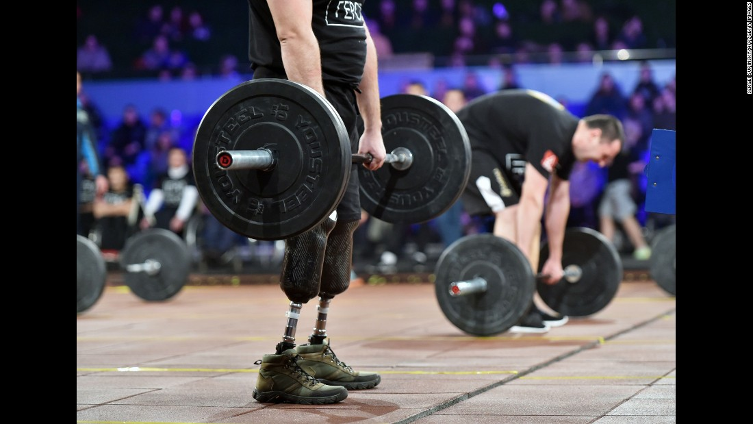 "Competitors lift weights in the ""Games of the Heroes"" final competition during the CrossFit Games in Kiev, Ukraine, on Saturday. Some 15 Ukrainian servicemen who became disabled during the fighting with pro-Russian separatists took part in the competition."