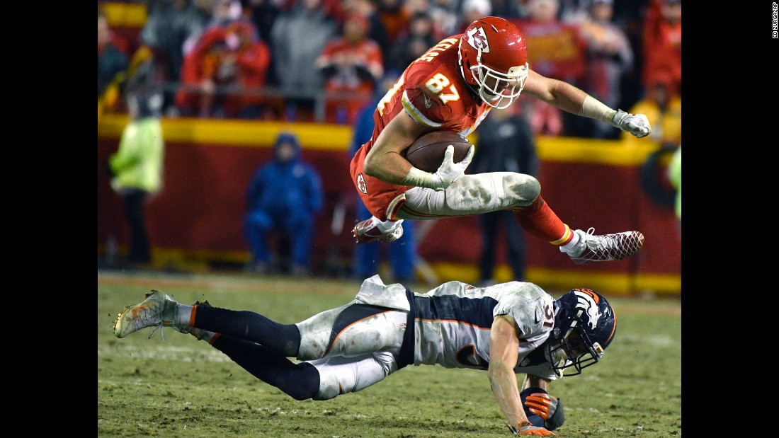 Kansas City tight end Travis Kelce leaps over Denver safety Justin Simmons during an NFL game in Kansas City, Missouri, on Sunday. Kansas City won 33-10.
