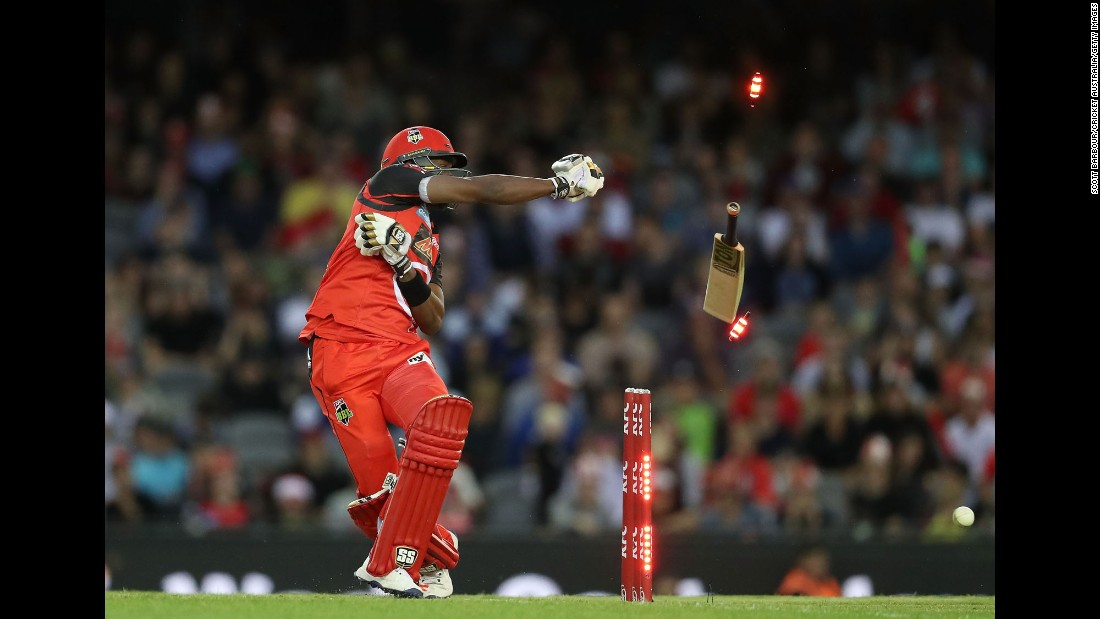 Melbourne's Dwayne Bravo loses grip of his bat as he is bowled out during a Big Bash League cricket match against Sydney in Melbourne, Australia, on Thursday.