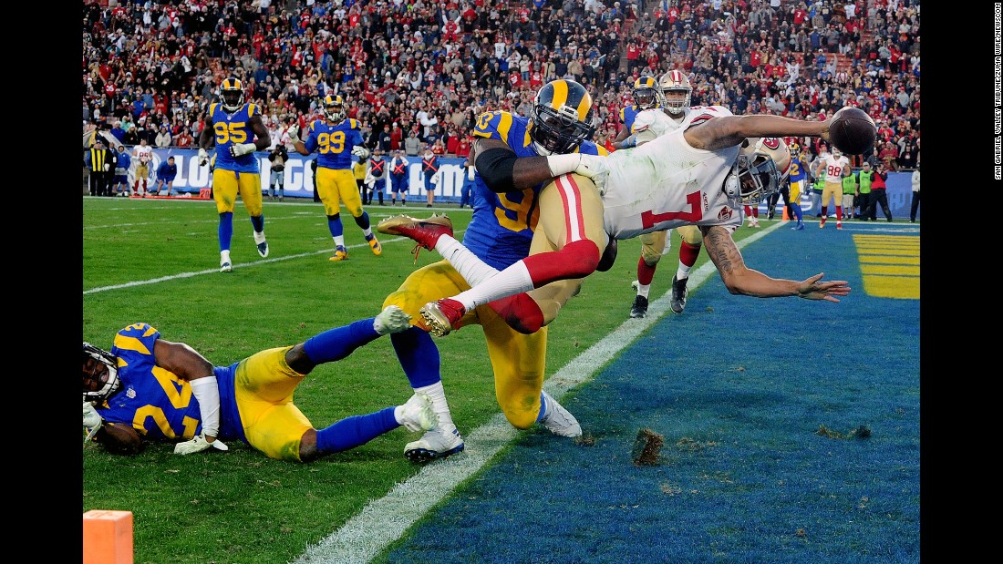 San Francisco quarterback Colin Kaepernick dives for the two-point conversion to give his team the lead over Los Angeles during an NFL game in Los Angeles on Saturday. San Francisco won 22-21.