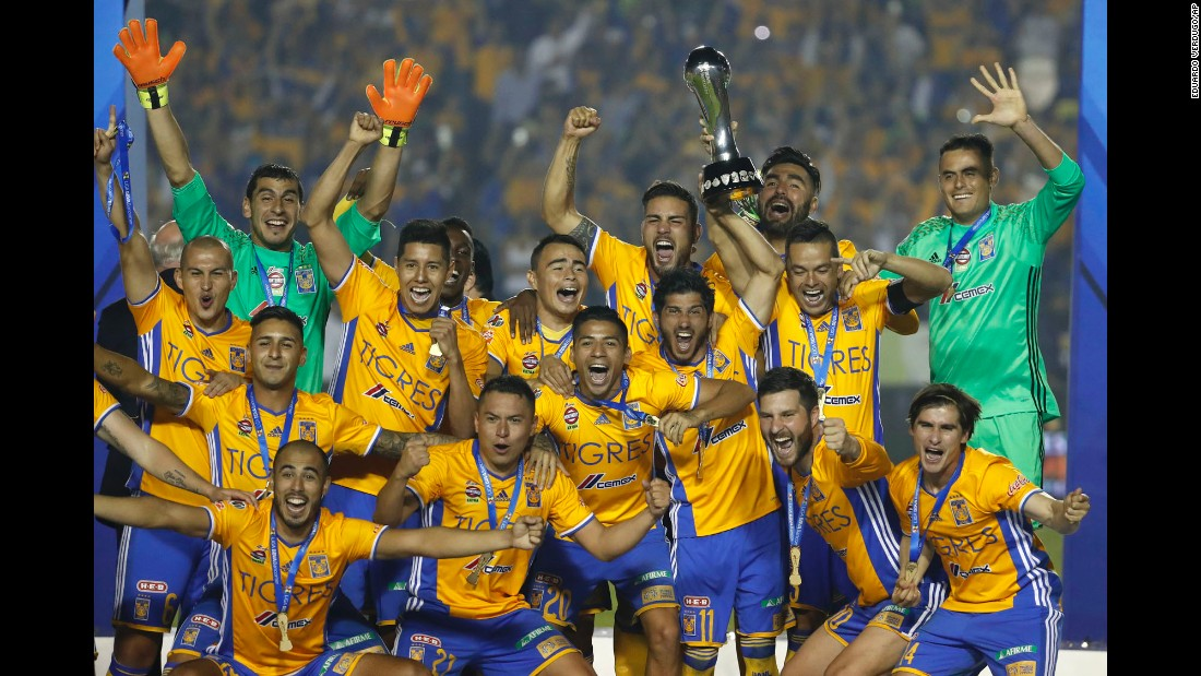 Tigres soccer players celebrate with the Mexican league trophy after defeating Club America in Monterrey, Mexico, on Sunday. Tigres won 3-0 on penalties after a 2-2 tie.