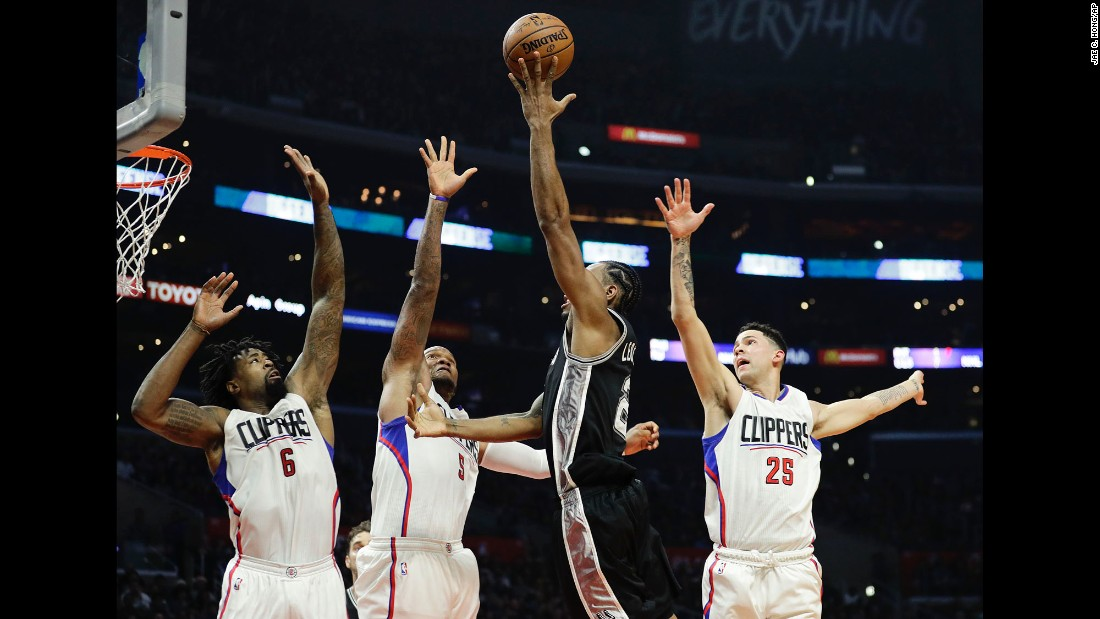 San Antonio's Kawhi Leonard drives to the basket against Los Angeles during an NBA game in Los Angeles on Thursday. Los Angeles won 106-101.