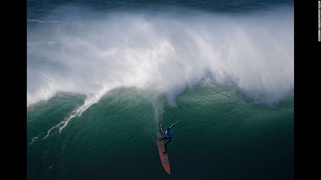 Professional surfer Nic Lamb rides a wave during the World Surf League's Nazare Challenge off Praia do Norte, Portugal, last Tuesday.