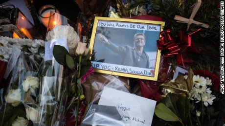LONDON, ENGLAND - DECEMBER 26:  A framed photograph of George Michael is left among tributes of flowers, candles and messages left at the home of the pop music icon in The Grove, Highgate on December 26, 2016 in London, England. Singer George Michael died on Christmas day in his country home in Oxfordshire at the age of 53 on December 25.  (Photo by Jack Taylor/Getty Images)
