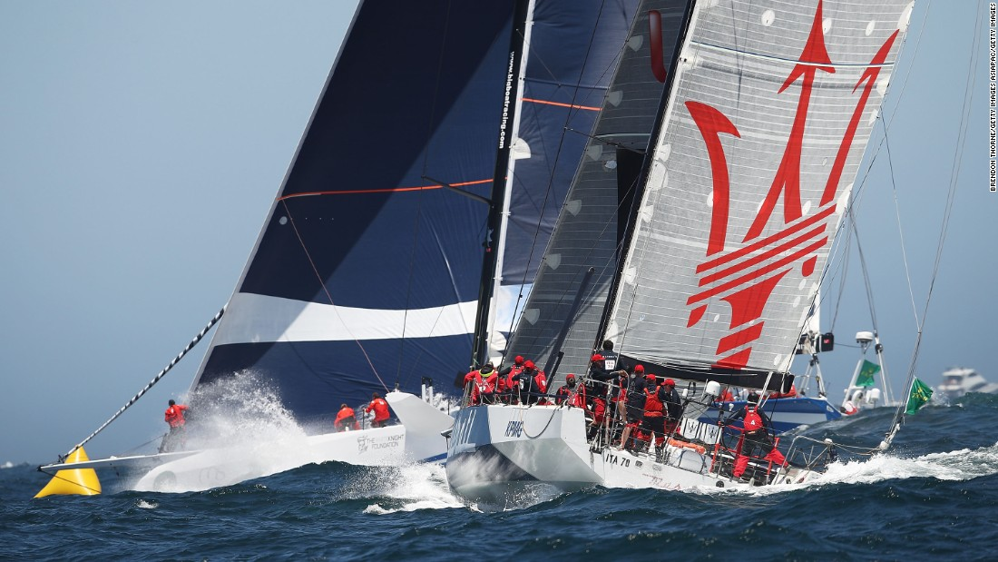 The fourth supermaxi in the fleet was CQS -- formerly the 90-foot Nicorette rebuilt in New Zealand for Finnish owner Ludde Ingvall, a two-time line honors winner of the race. It finished seventh. Here CQS (left) heads out to sea with the 70-foot Maserati, which crossed sixth as both boats were becalmed for hours in the Derwent River when the wind died.
