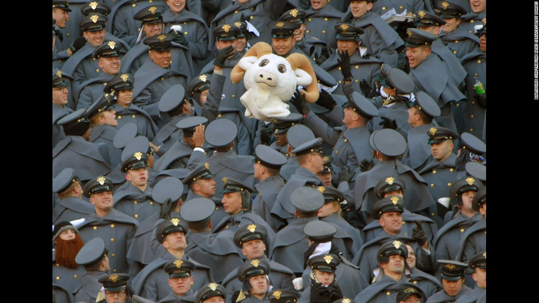 "Army cadets toss the head of Navy's ""Bill the Goat"" mascot during a football game between the Army Black Nights and the Navy Midshipmen on Saturday, December 10. Army won, 21-17."