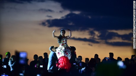 Rubi Ibarra (C)dances during her 15th birthday celebrations in Villa Guadalupe, San Luis Potosi State, on December 26, 2016.  Rubi, a small-town Mexican teen, welcomed thousands of guests for her 15th birthday party  after her parents' video invitation to the milestone event went viral online.   / AFP / RONALDO SCHEMIDT        (Photo credit should read RONALDO SCHEMIDT/AFP/Getty Images)