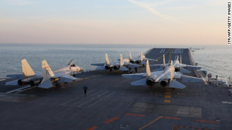 Chinese J-15 fighter jets wait on the deck of the Liaoning aircraft carrier during military drills in December.