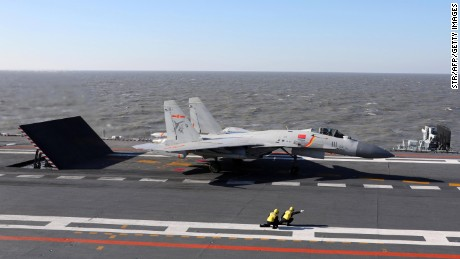 This picture taken on an undisclosed date in December 2016 shows a Chinese J-15 fighter jet preparing to take off from the deck of the Liaoning aircraft carrier during military drills in the Bohai Sea, off China's northeast coast. China's Liaoning aircraft carrier battle group has conducted its first exercises with live ammunition, the country's navy said, in a show of strength as tensions with the US and Taiwan escalate. China's first and only aircraft carrier led large-scale exercises in the Bohai Sea, the People's Liberation Army Navy said late on December 15, 2016 in a statement on their website. / AFP / STR / China OUT        (Photo credit should read STR/AFP/Getty Images)