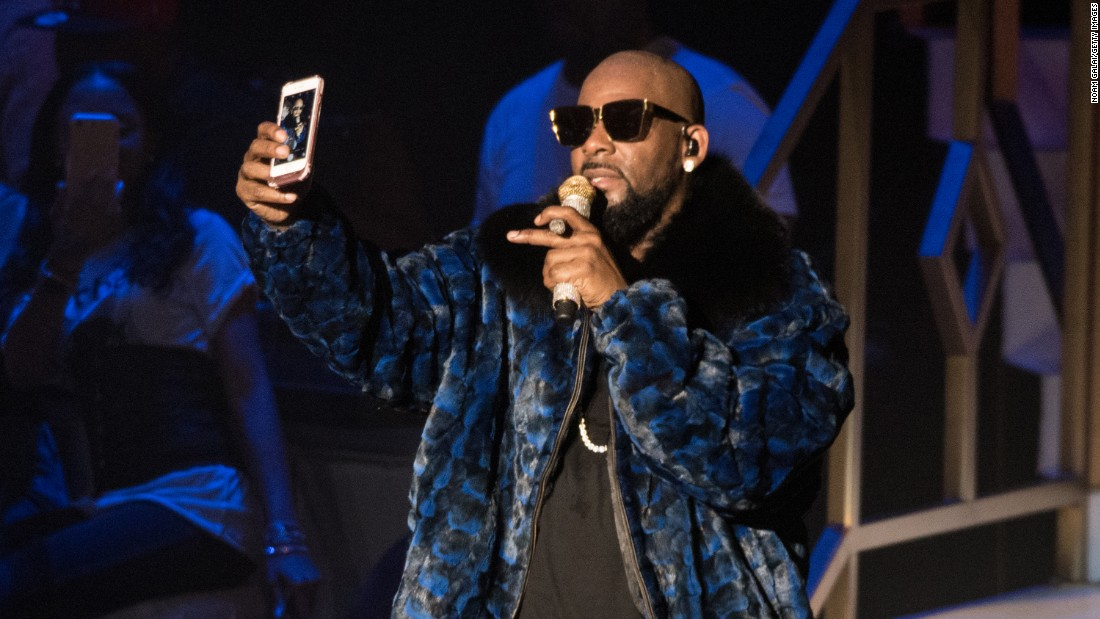 Singer R. Kelly takes a selfie while performing in New York City on Saturday, December 17.