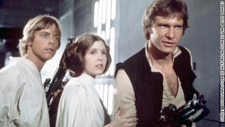 "Hamill and Fisher with co-star Harrison Ford in the original ""Star Wars"" (1977)."