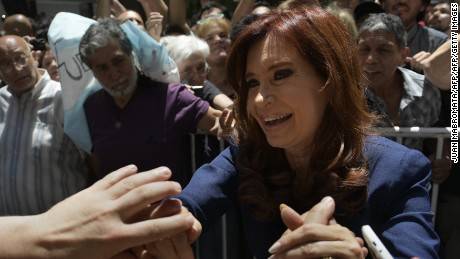 Argentina's former President Cristina Fernandez de Kirchner is greeted by supporters after visiting the Cuban embassy in Buenos Aires on November 29, 2016 to pay homage to late Cuban revolutionary leader Fidel Castro who died in Havana on November 25 at age 90. / AFP / Juan MABROMATA        (Photo credit should read JUAN MABROMATA/AFP/Getty Images)