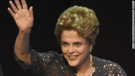Former Brazilian President Dilma Rousseff waves during a meeting at the UMET (Universidad Metropolitana para la Educacion y el Trabajo) in Buenos Aires, on December 22, 2016 where she gave a lecture on democracy and social justice. / AFP / EITAN ABRAMOVICH        (Photo credit should read EITAN ABRAMOVICH/AFP/Getty Images)