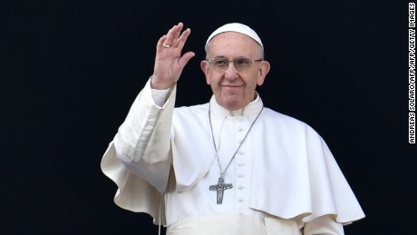 "Pope Francis waves from the balcony of St Peter's basilica during the traditional ""Urbi et Orbi"" Christmas message to the city and the world, on December 25, 2016 at St Peter's square in Vatican. Pope Francis offered his thoughts to victims of terrorism in his annual Christmas address, days after the truck attack that left 12 dead at a festive Berlin market. / AFP / ANDREAS SOLARO        (Photo credit should read ANDREAS SOLARO/AFP/Getty Images)"