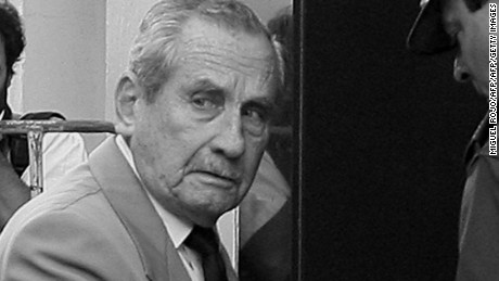 Former Uruguay's President(1981-1985) during the military dictatorship General (retired) Gregorio Alvarez (C), arrives at the court in Montevideo, on December 5th, 2007, to testify about human rights violations during the military regime. The Court investigates the illegal transfer from Argentina to Uruguay, of some 40 political prisoners in 1978. AFP PHOTO/MIGUEL ROJO (Photo credit should read MIGUEL ROJO/AFP/Getty Images)
