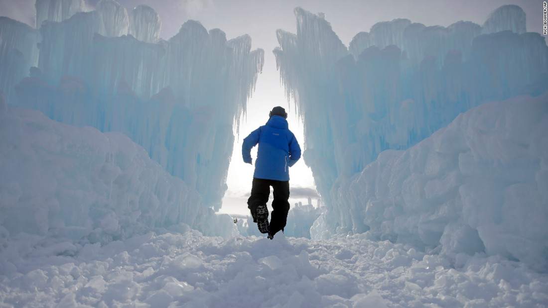 A worker walks through the Ice Castles in Midway, Utah. The public can now tour the complex, which is made of hundreds of thousands of icicles.