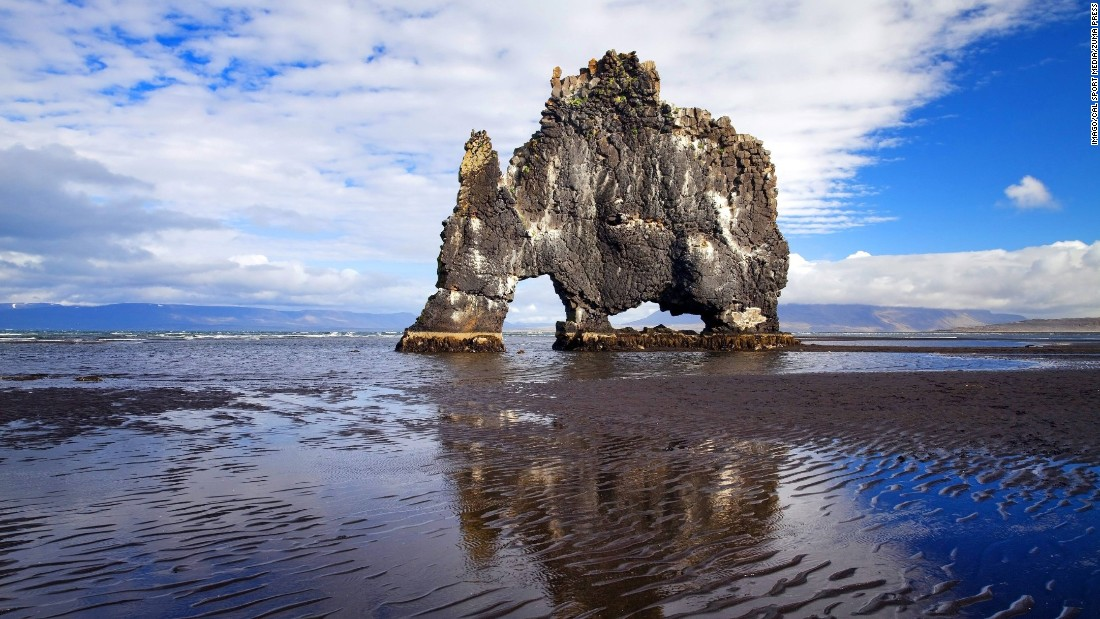 Just off the shore of Vatnsnes peninsula in northwest Iceland stands Hvítserkur, a 15-meter-high monolith that local legend claims is a petrified troll.