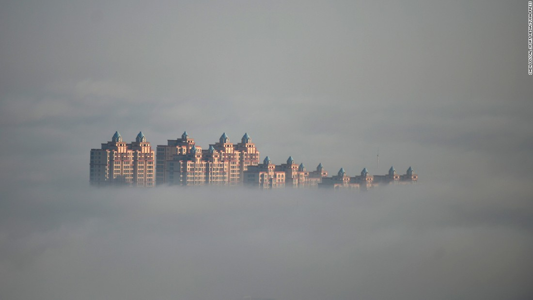 Advection fog, which forms when stable, warm and moist air is blown across a cooler surface, appears in Xingtai City, China.