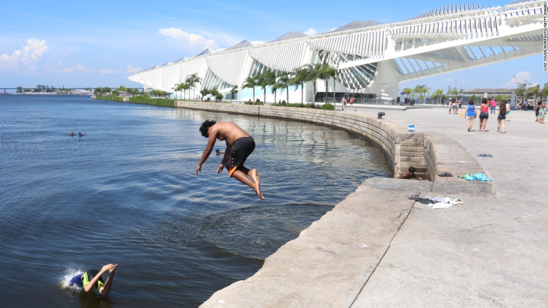 As Rio de Janeiro temperatures reached 100 degrees Fahrenheit (43.4 degrees Celsius) on December 26, children jumped into the polluted waters of Guanabara Bay to cool off.