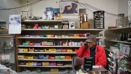 """Percy Nayokpuk owns one of two stores in town. """"Climate change is happening,"""" he says."""