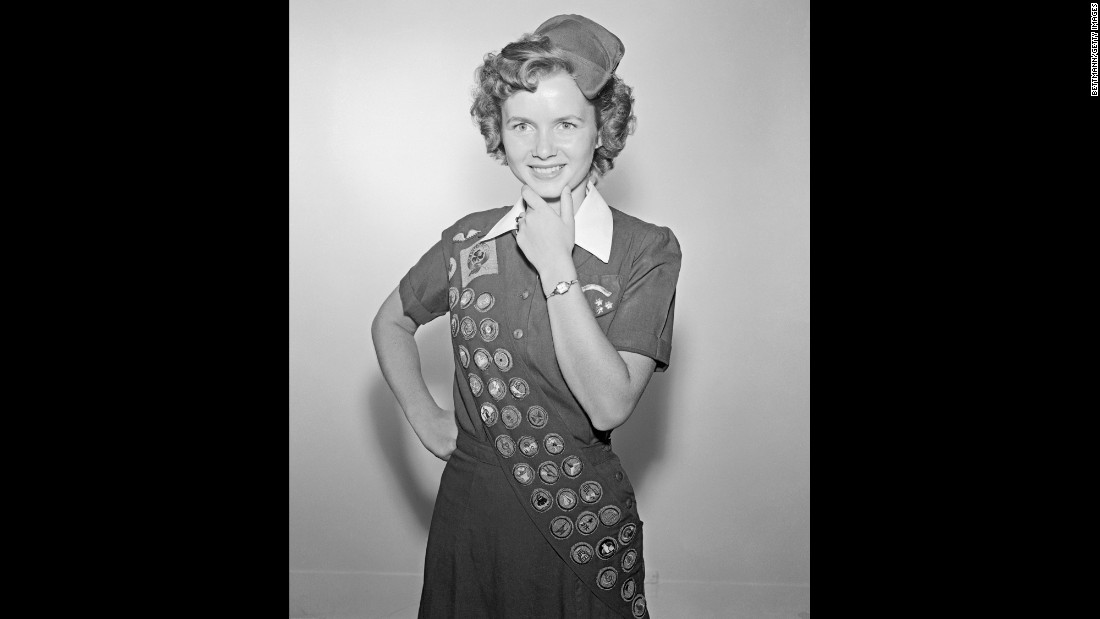 Reynolds was a proud member of the Girl Scouts.  At the time of this photo, at age 17, she had earned 42 out of a possible 100 badges in eight years of scouting.