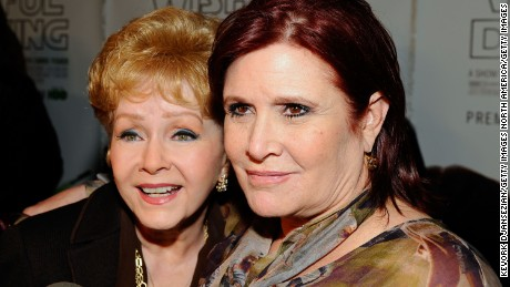 "HOLLYWOOD, CA - DECEMBER 07:  Actresses Debbie Reynolds and Carrie Fisher arrive at the premiere of the HBO documentary ""Wishful Drinking"" at Linwood Dunn Theater at the Pickford Center for Motion Study on December 7, 2010 in Hollywood, California.  (Photo by Kevork Djansezian/Getty Images)"
