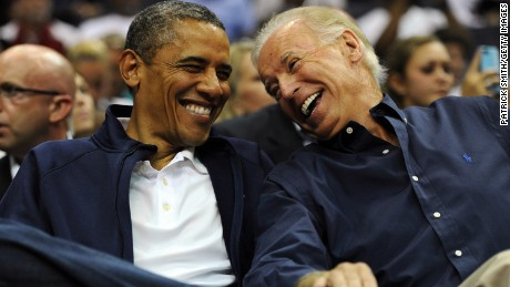 U.S. President Barack Obama and Vice President Joe Biden share a laugh as the US Senior Men's National Team and Brazil play during a pre-Olympic exhibition basketball game at the Verizon Center on July 16, 2012 in Washington, DC.