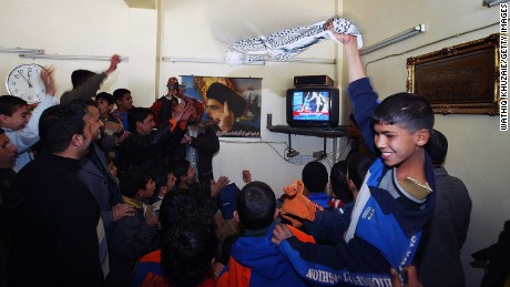 Iraqis celebrate In Sadr City after hearing about the execution of Saddam Hussein.