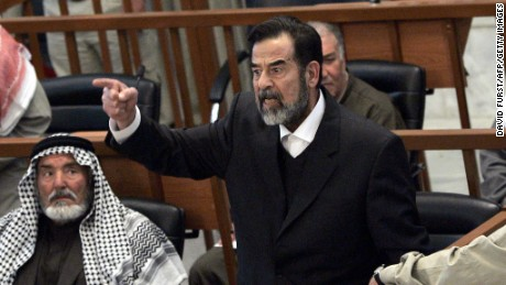 Former Iraqi president Saddam Hussein chastises the court moments after his half brother, Barzan Ibrahim al-Tikriti, was forcibly removed from their trial held in Baghdad's heavily fortified Green Zone, 29 January, 2006.