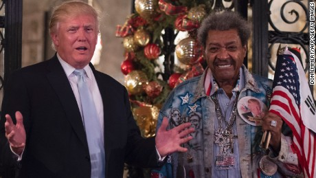 US President-elect Donald Trump, along with boxing promoter Don King,  answers questions from the media after a day of meetings on December 28, 2016 at Mar-a-Lago in Palm Beach, Florida.