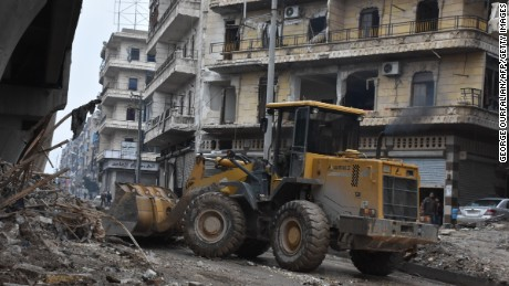 Tractors are seen as the Syrian government starts to clean up areas formerly held by opposition forces in the northern city of Aleppo on December 27, 2016.